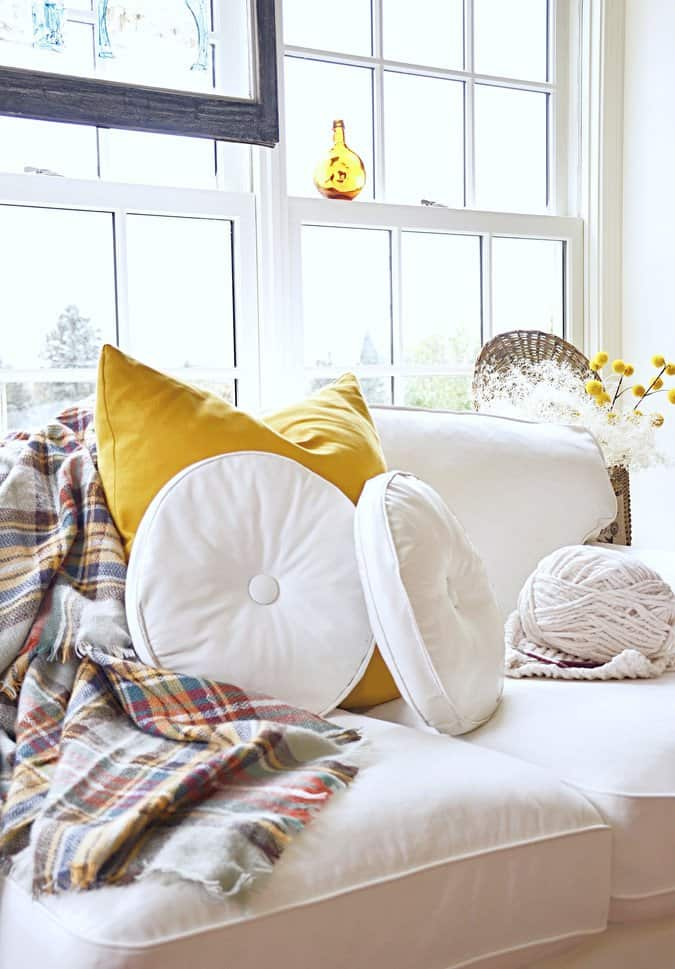 Sunroom decorated for fall with gold touches and vintge finds.