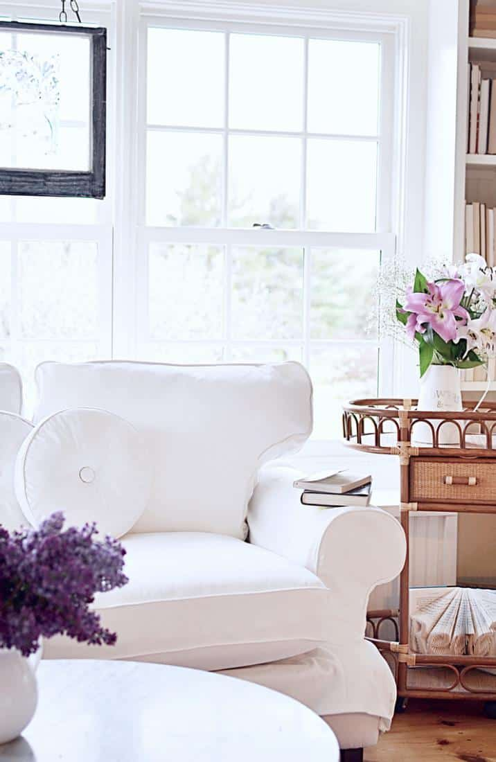Sunroom makeover w/ white loveseat and vintage wicker beverage cart.