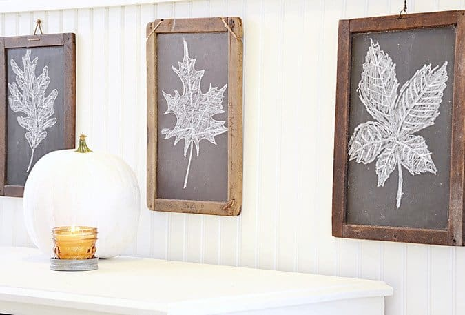 Vintage children's chalkboards decorated in entryway for fall.