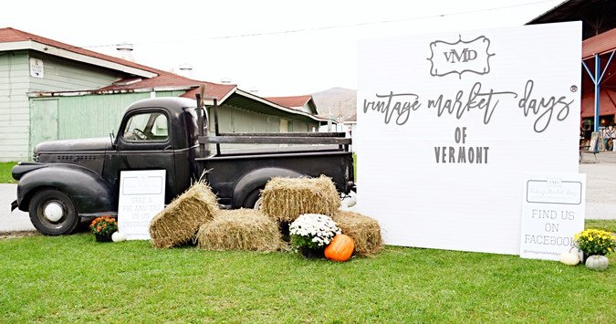 Vintage black truck with Vintage Market Days Welcome Sign.