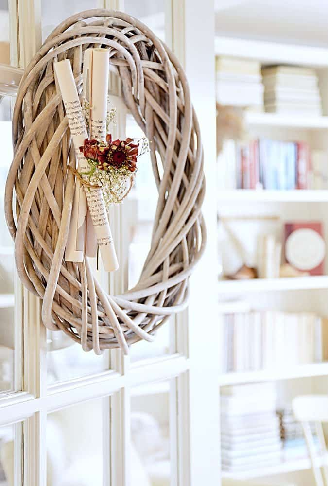 Wooden Wreath with book pages and flowers on french door.