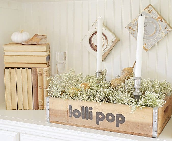 Vintage lolli pop crate with vintage book collection.