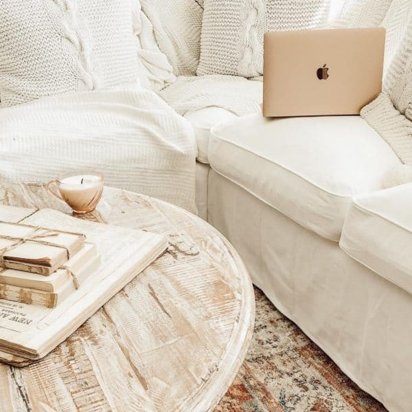 white sectional coach with open laptop