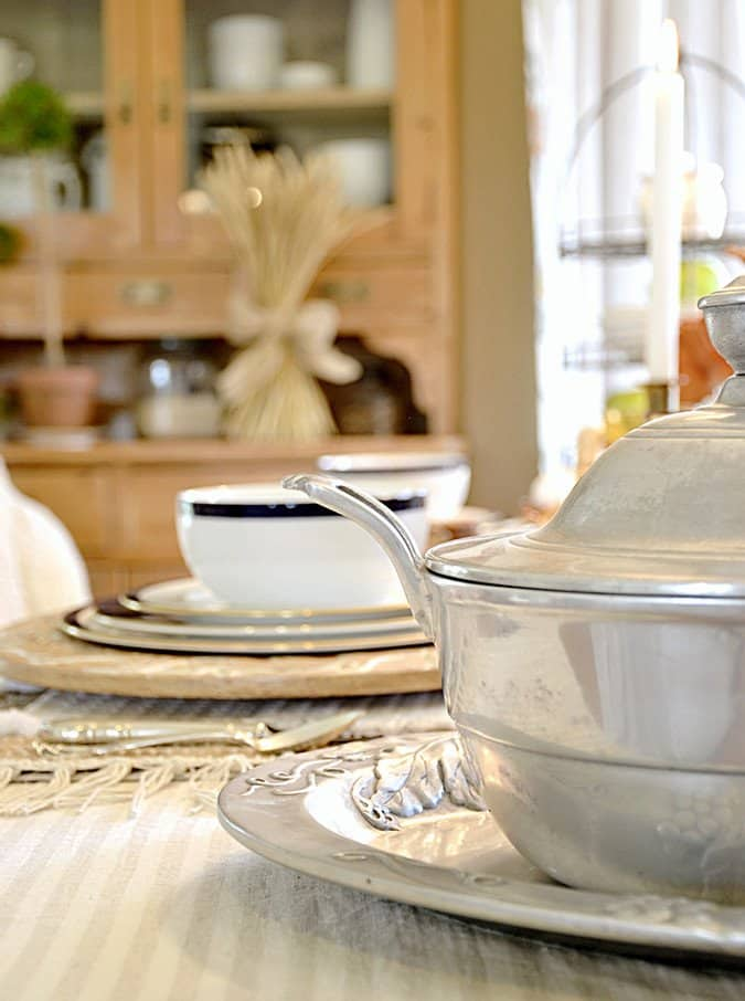 Soup bowl server on table scape.