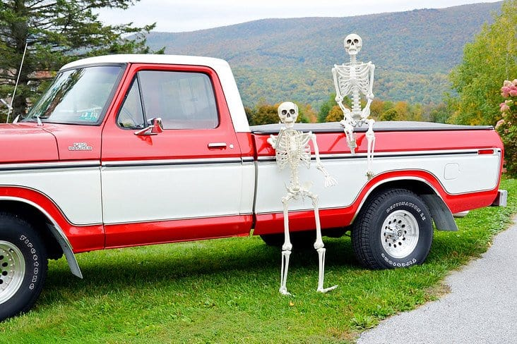Halloween skeletons and Vintage Ford truck in the mountains.