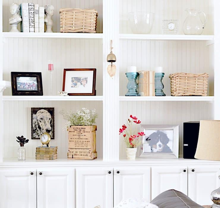 Built-Ins with vintage books, baskets, candles and more.