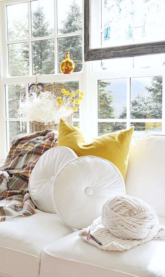Sunroom decorated with golden vintage finds.