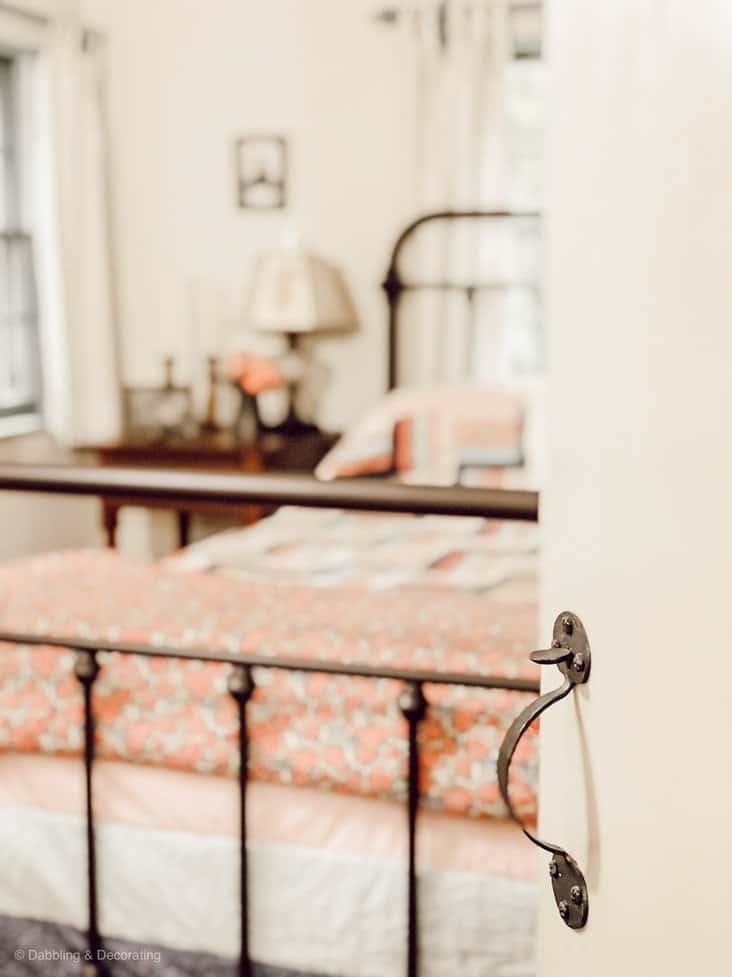 Guest bedroom entryway with latched door.