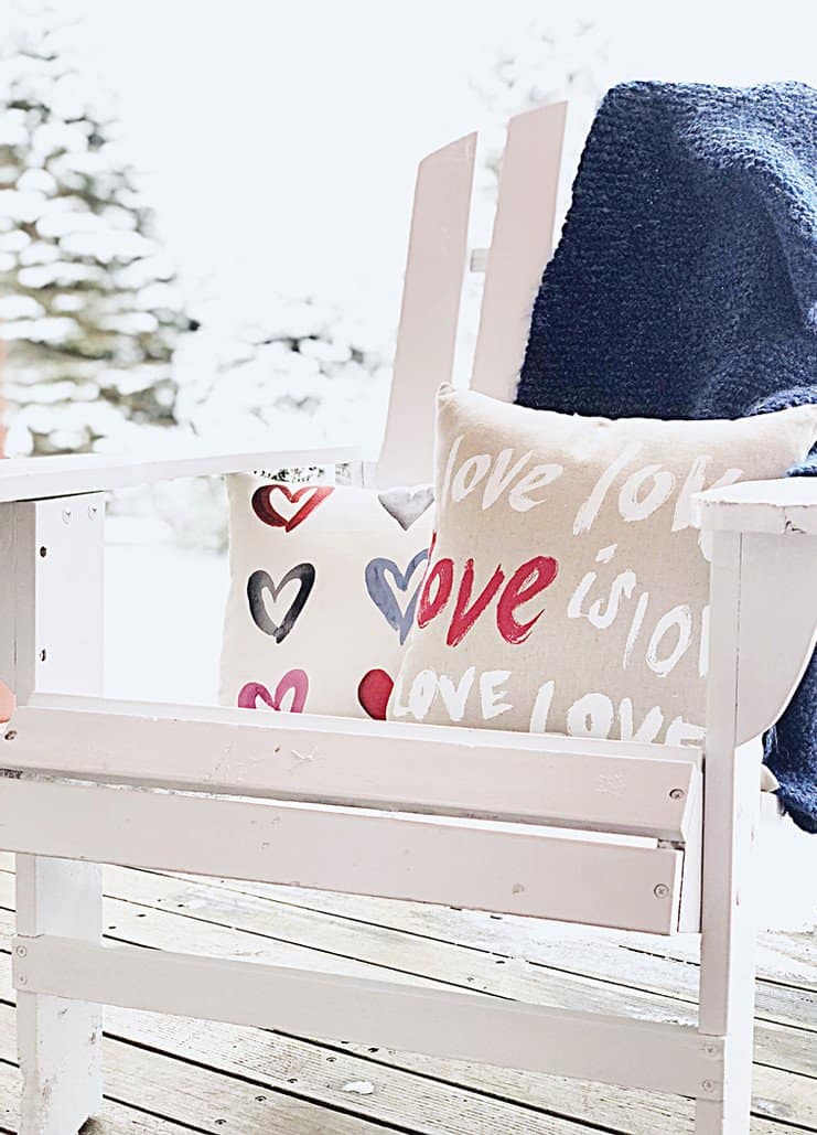Adirondack chair winter decor with Valentines Day pillows