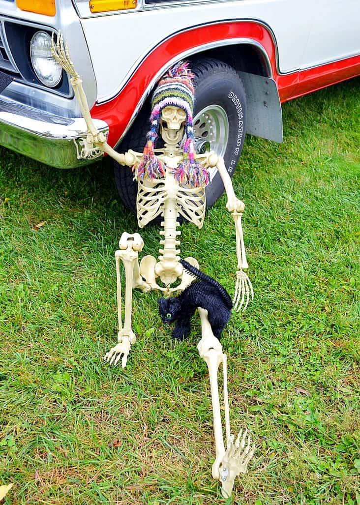 Halloween skeleton under truck tire.