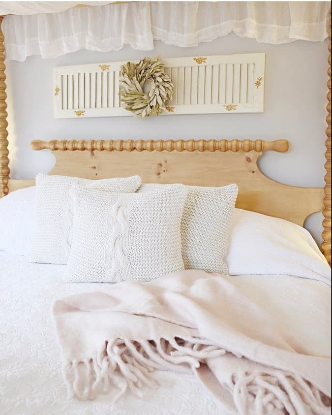 Master Bedroom with Canopy Bed and Vintage Shutter