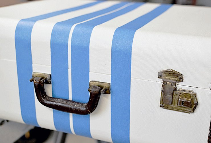 Vintage suitcase with painters tape for DIY