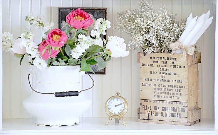 Shelfie with vintage finds and flowers.
