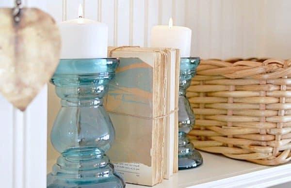 blue candlesticks and a basket