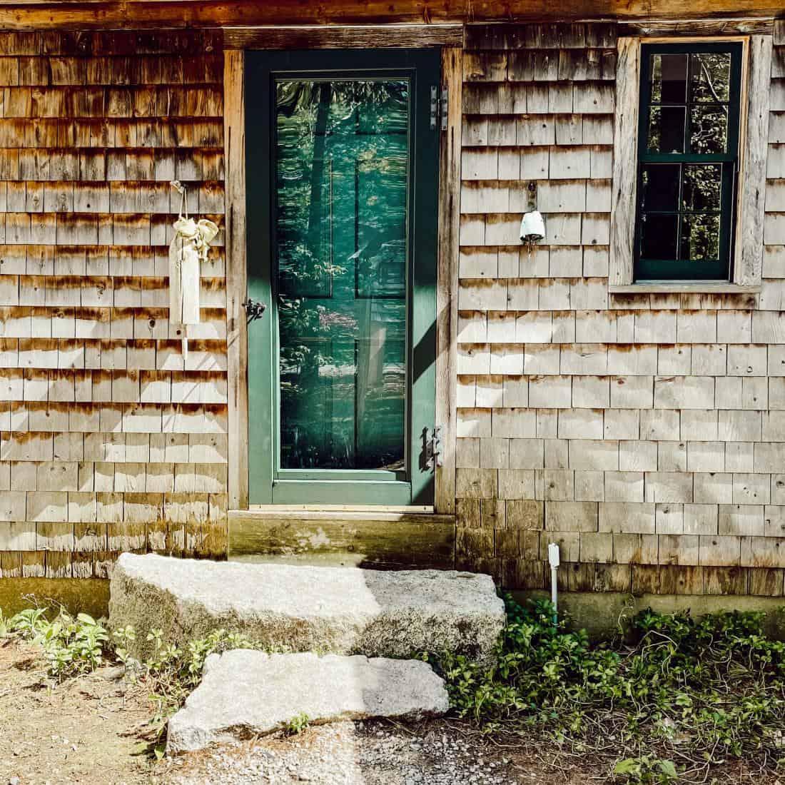 front door with cedar shake siding