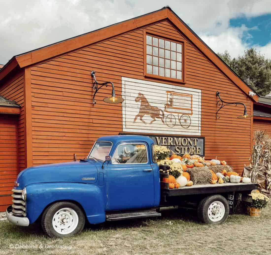 A blue truck parked in front of The Vermont Country Store