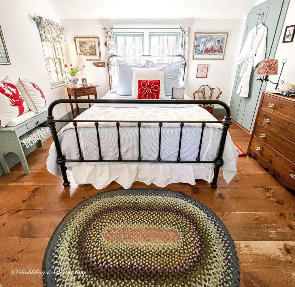 Guest bedroom decorated with Schweitzer Linens seersucker bedding.