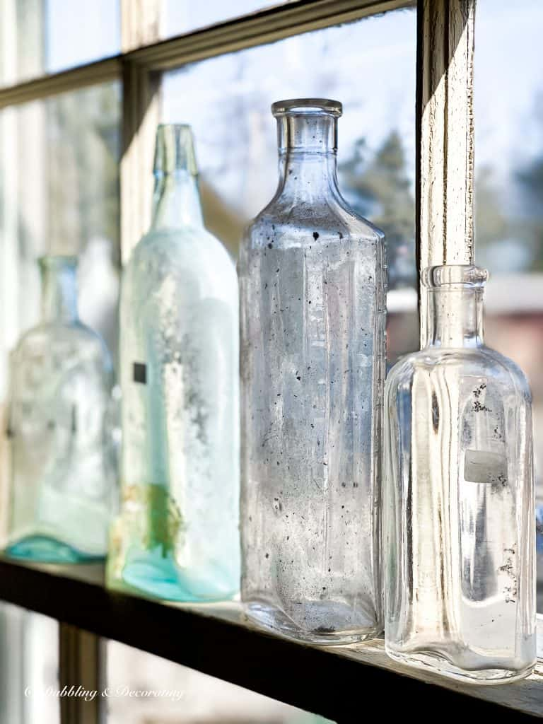 A close up of a bottle next to a window