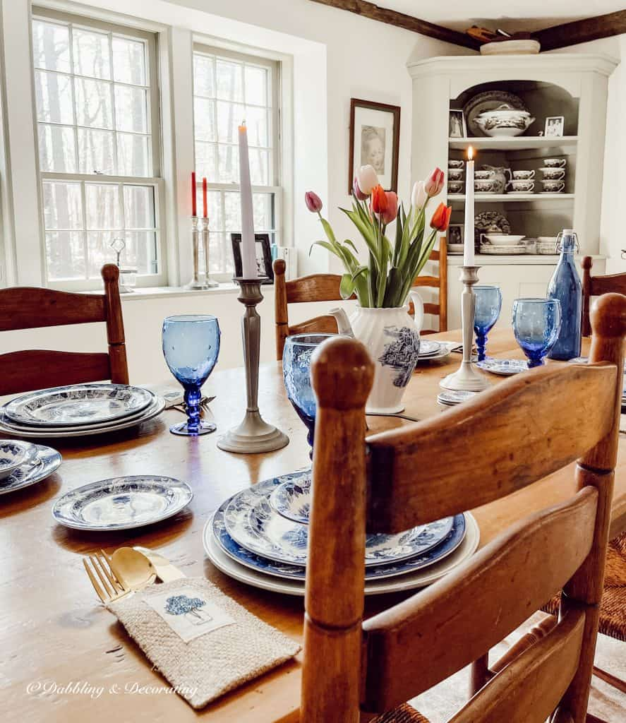 Blue and white antique table setting with tulips