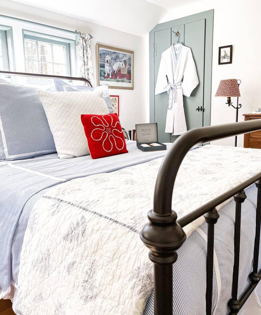 Blue and white seersucker bedding in coastal vintage styled bedroom.