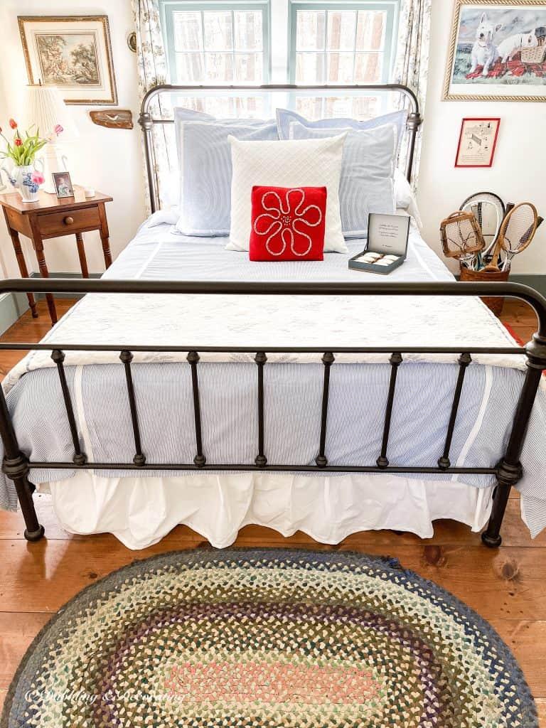 Coastal styled guest bedroom with seersucker bedding.