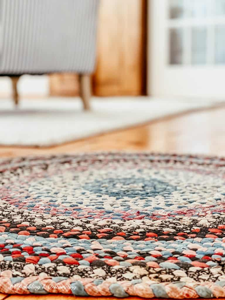 A close up of a colorful braided rug