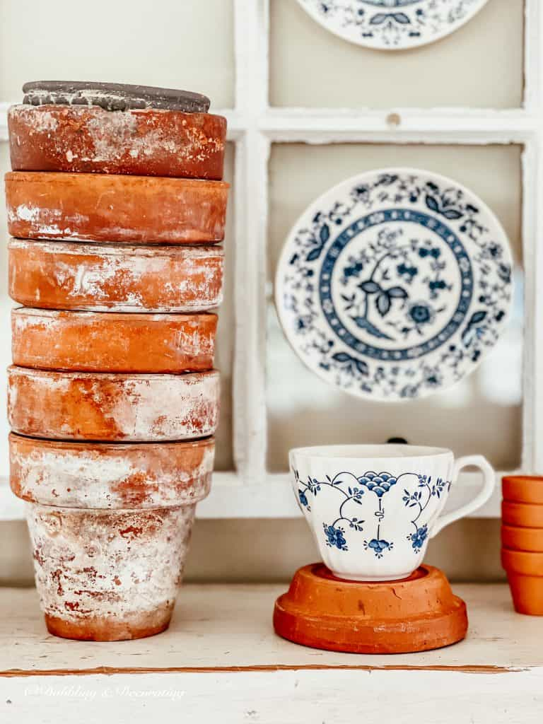 Terracotta pots and a teacup,