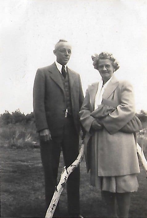 A vintage photo of a man and woman posing for a picture