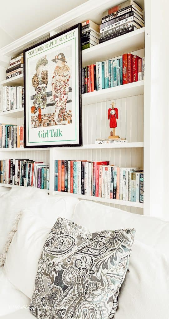 A bed with a book shelf