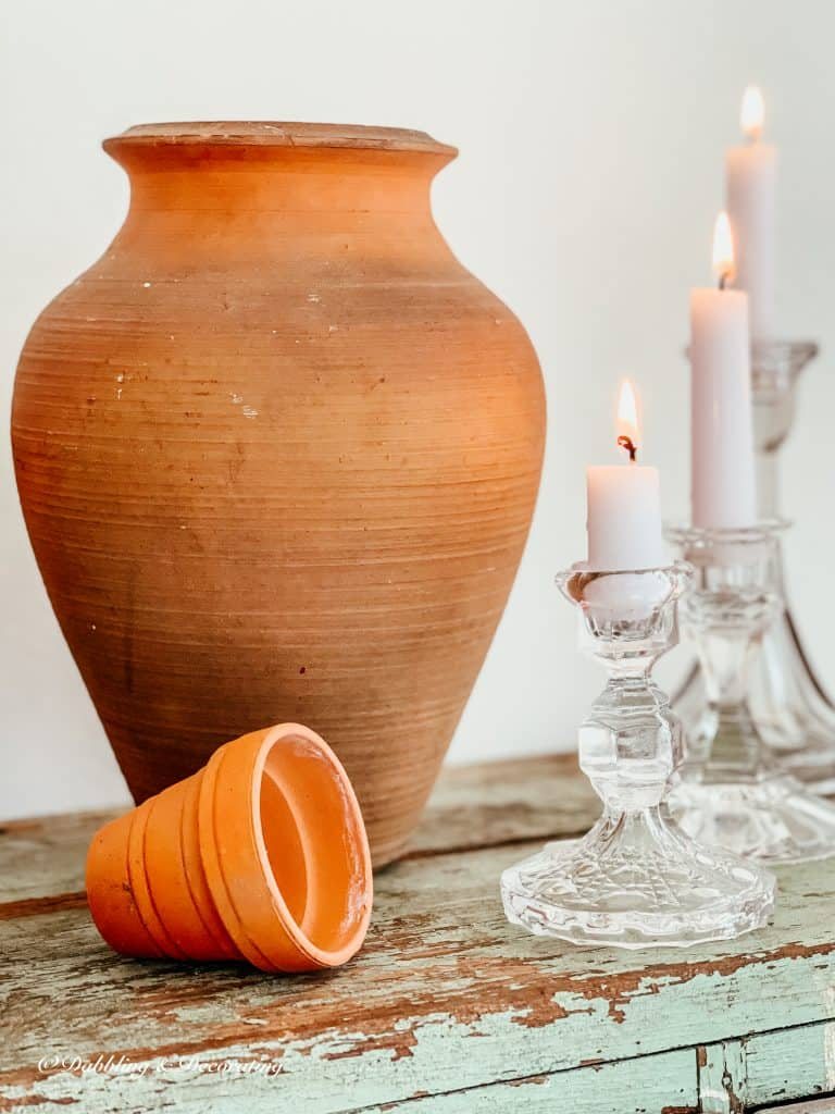 Terracotta pots and glass candlesticks.