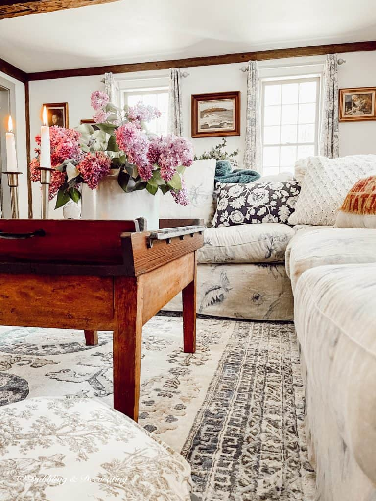Living room coffee table with lilacs.