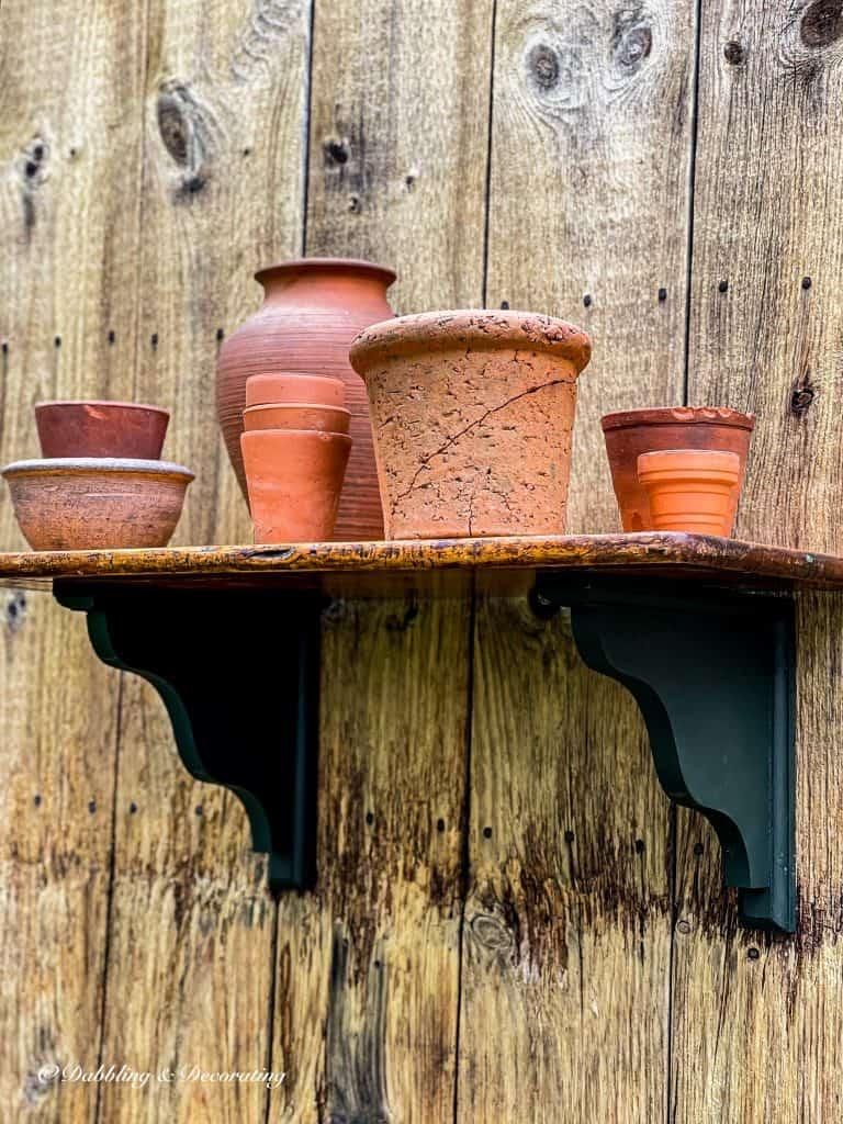 Outdoor DIY Planter Shelf with terracotta pots.