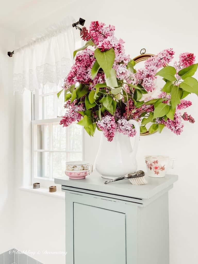 Lilacs in the bathroom.