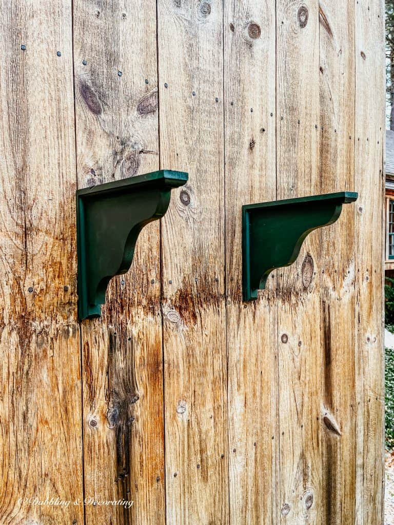 two green wooden shelf holders