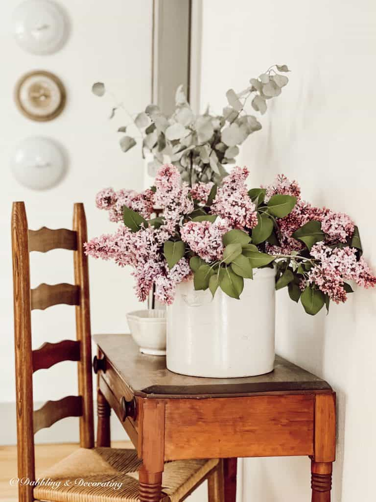 Lilacs on an antique table.