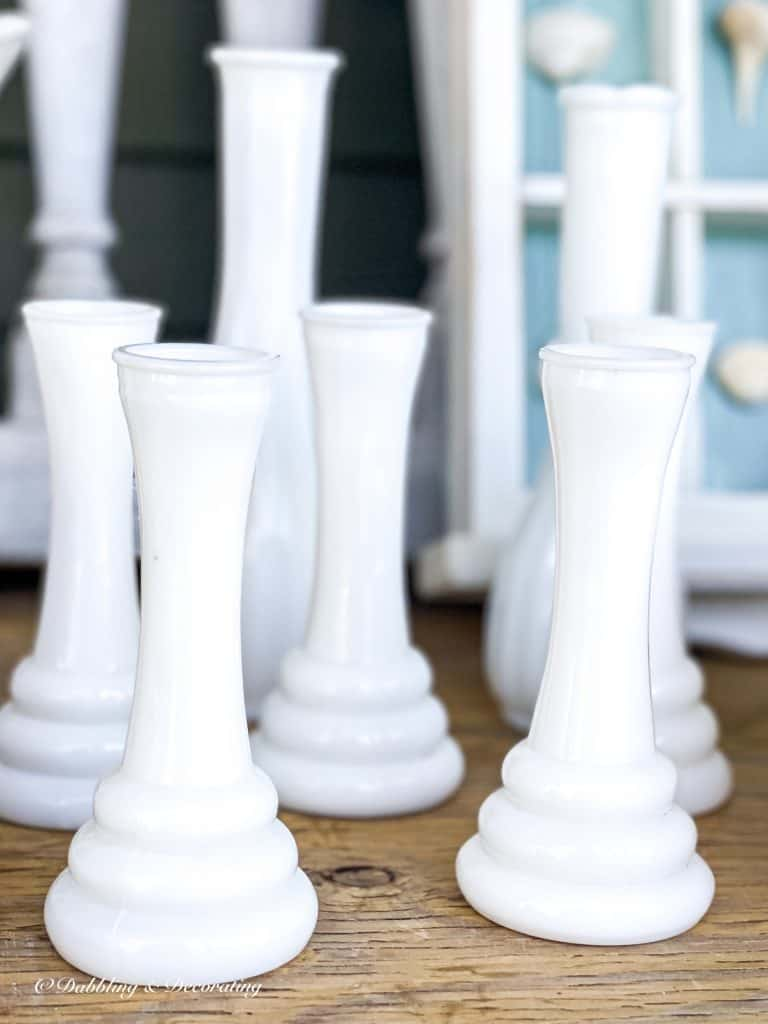 5 Clever Ways to Decorate with Yard Sale Finds.  Milk glass bud vases.