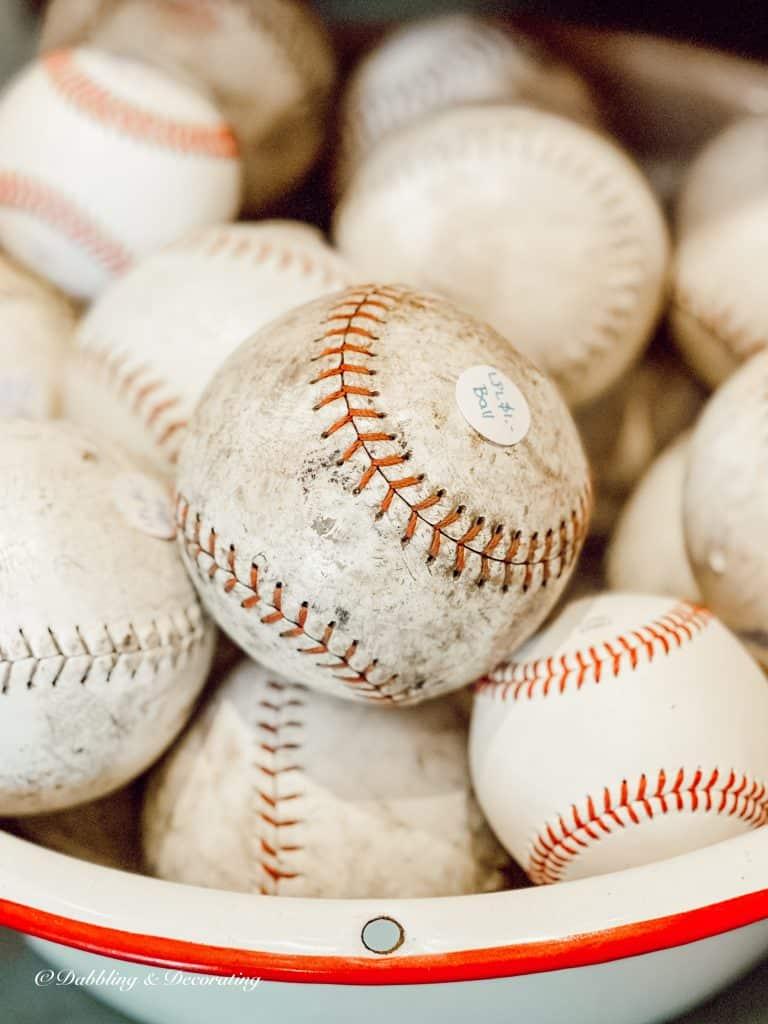 bucket of old baseballs