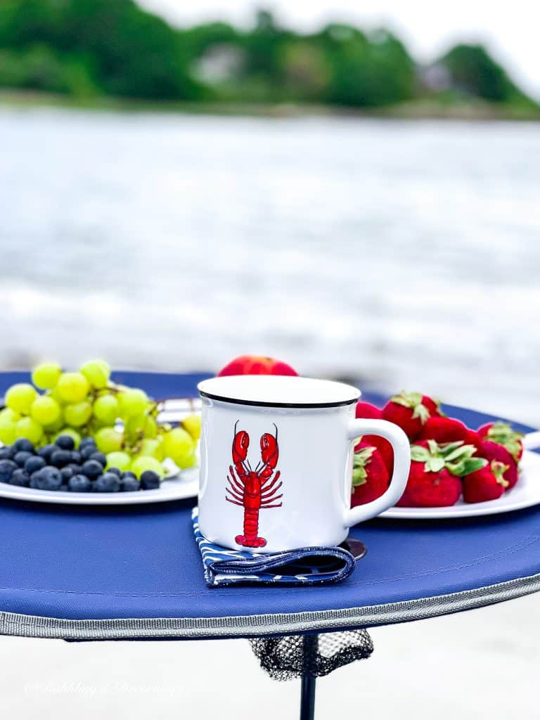 My Favorite Beach Day Essentials.  Lobster Mug and fruit.