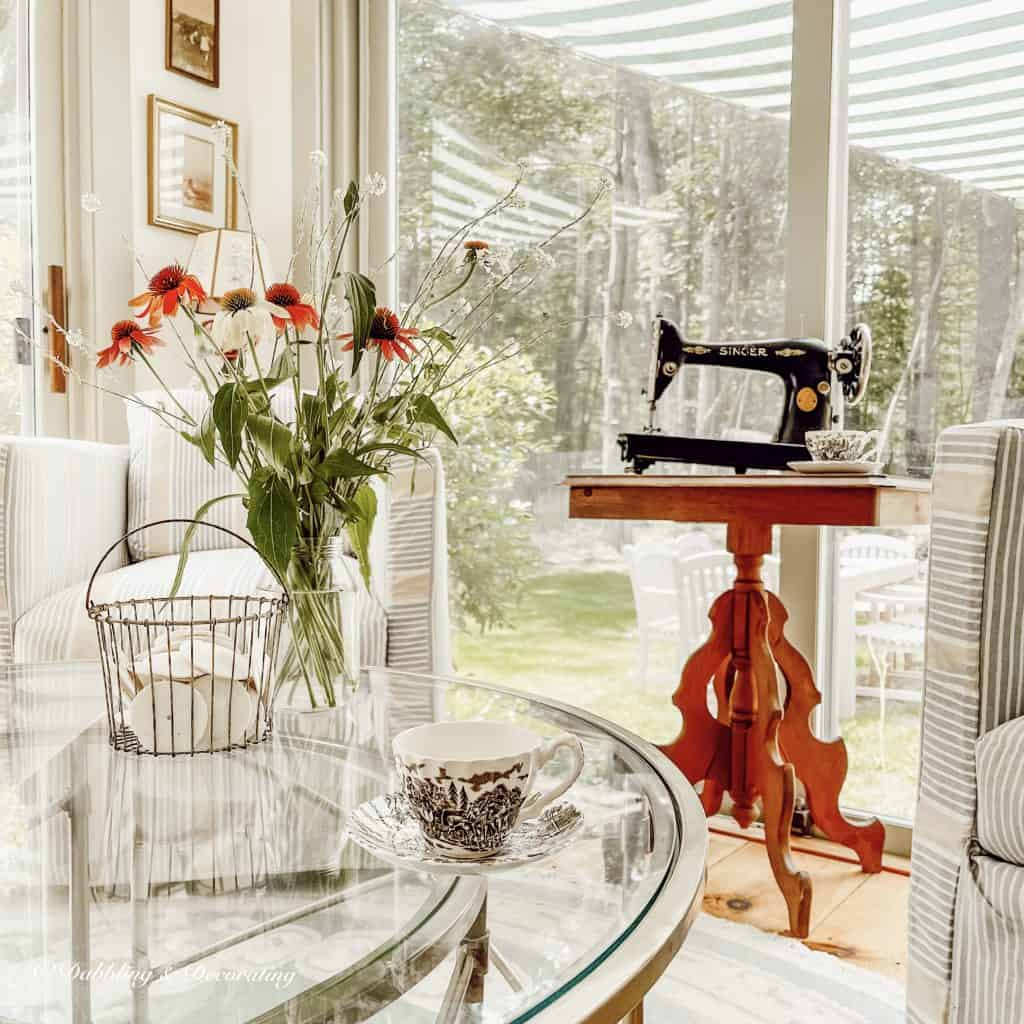 Vintage Sewing Machine on wooden table in sunroom.