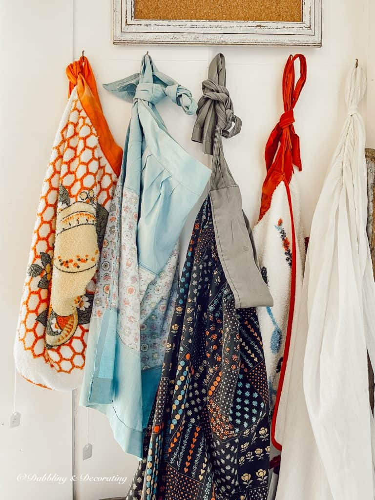 Aprons hanging on a wall
