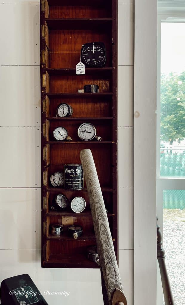 A wooden shelf sitting inside of a building