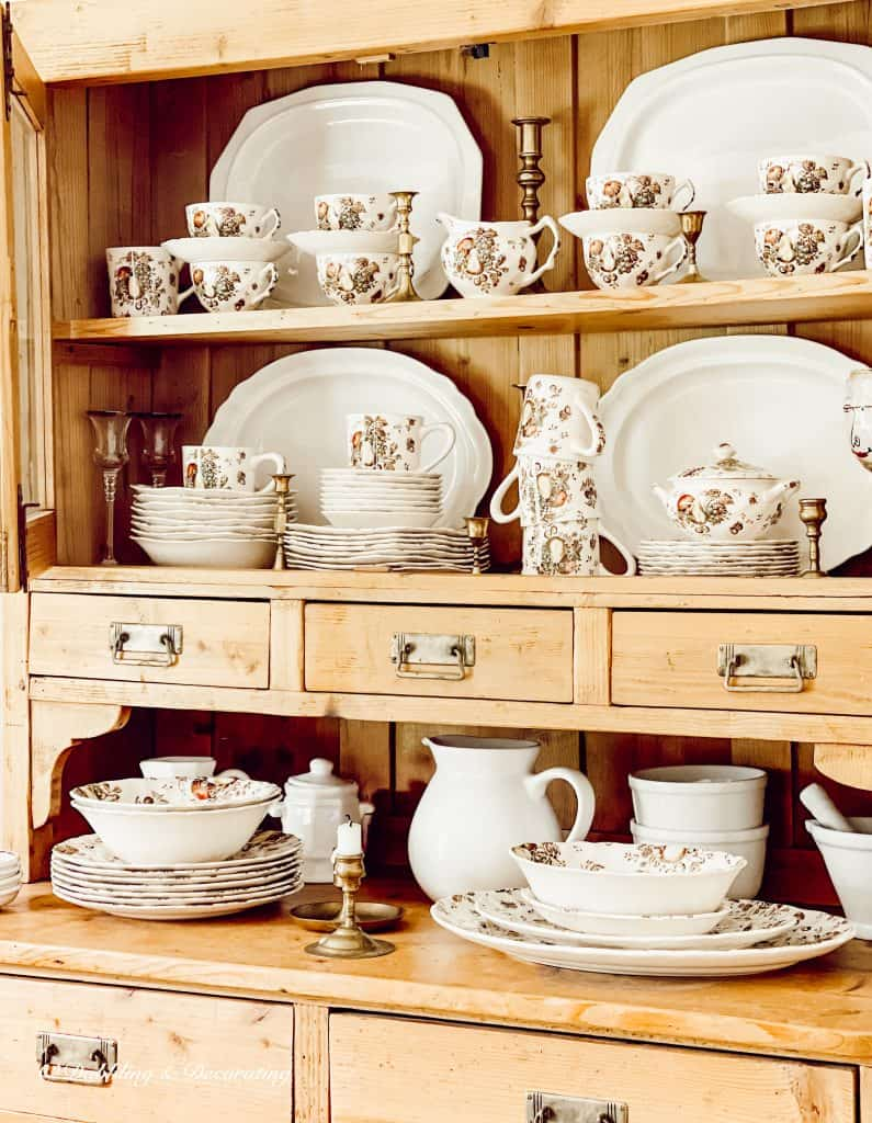 Thrifting with the Gals from Vermont to Maine Autumn Delight Dishware in pine cupboard.