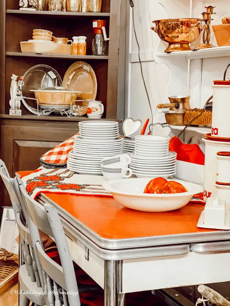 A kitchen with a plate of food on a table, with Design