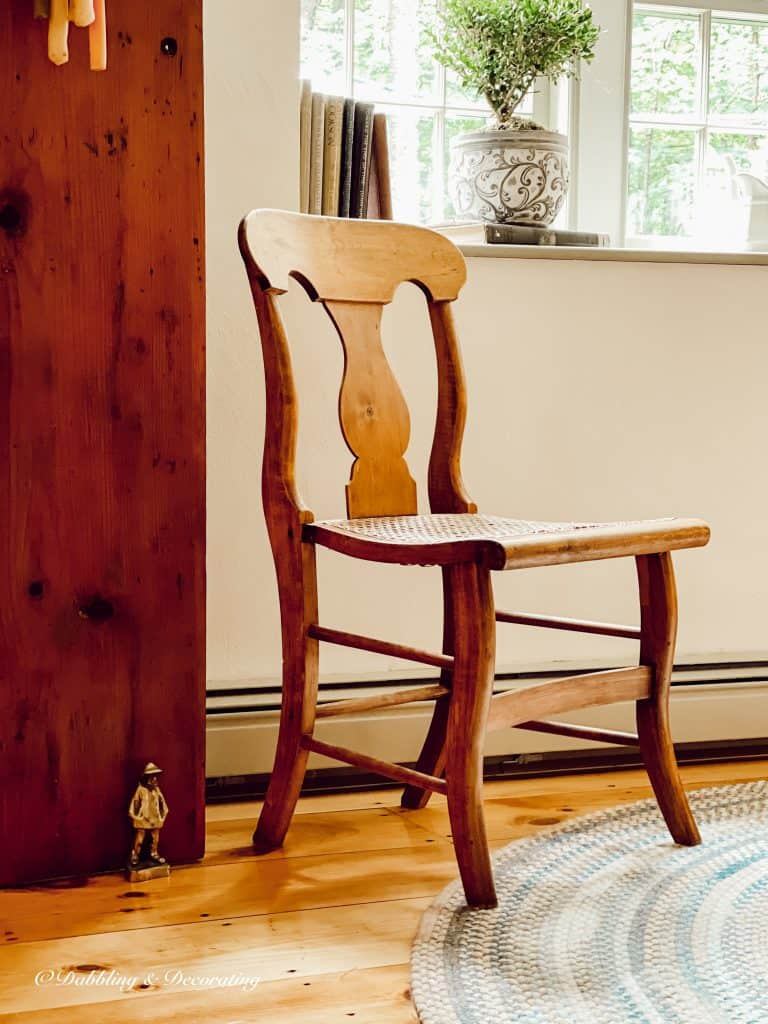 Vintage Dining room with cane chair.