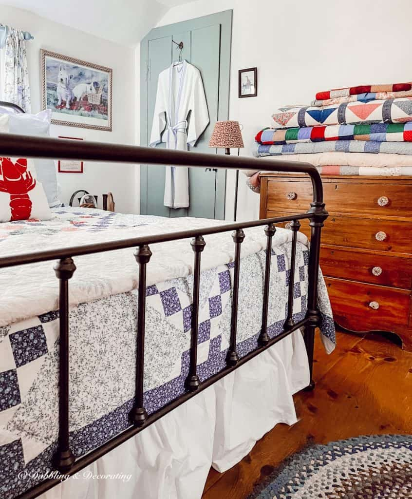 Bedroom with folded and displayed quilts