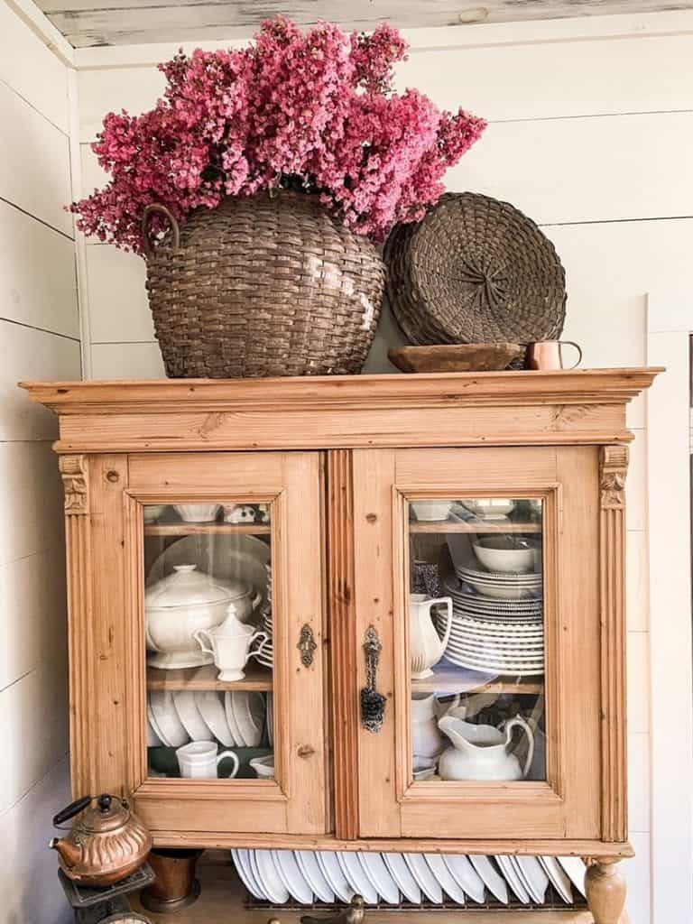 Pine cabinet with pink flowers