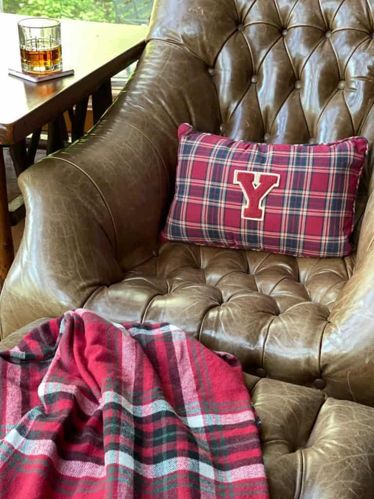 Leather chair with varsity letter pillow