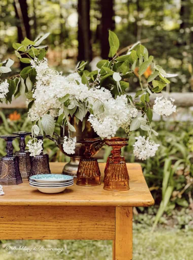 Vintage Table with hydrangea and colored glassware from second hand shops