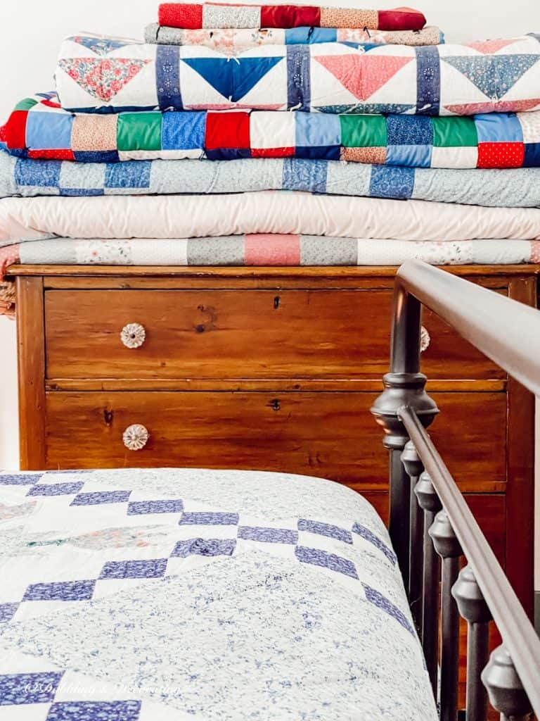 Folded Quilts on Wooden Dresser
