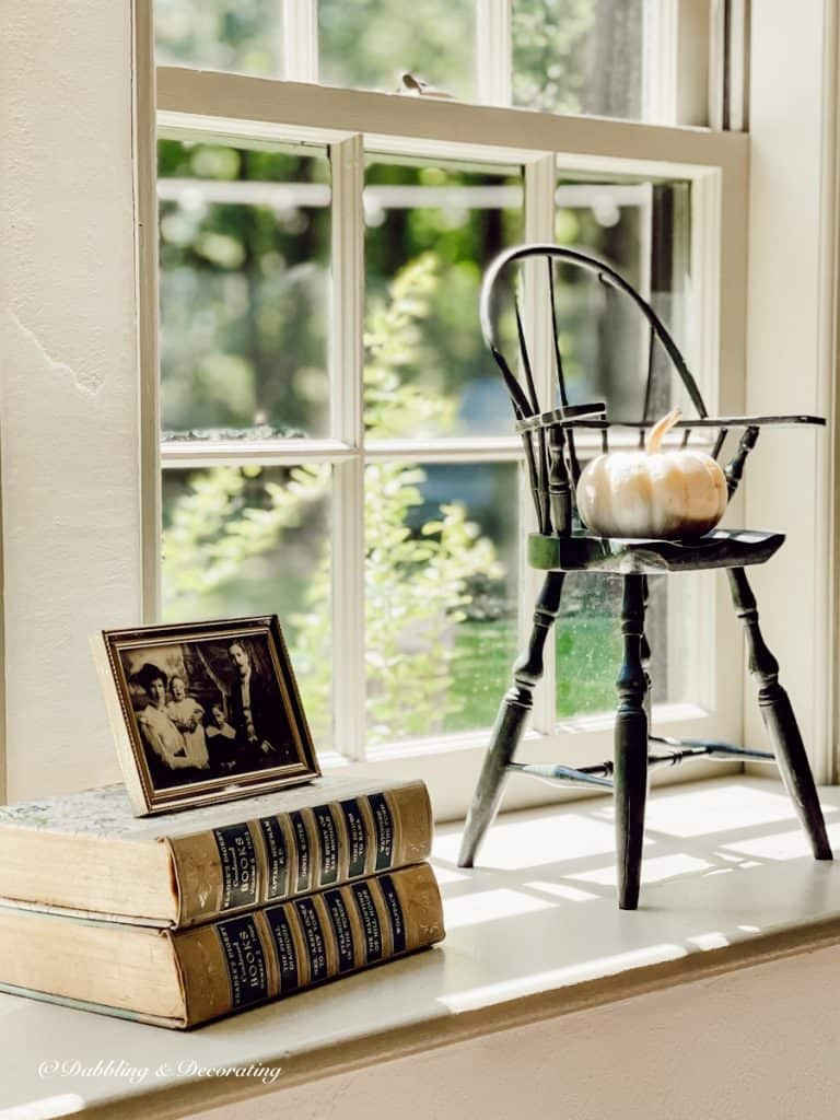 Doll Chair with Pumpkin and  books and photo.